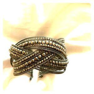 Pewter tone braided cuff bracelet. A trendy piece